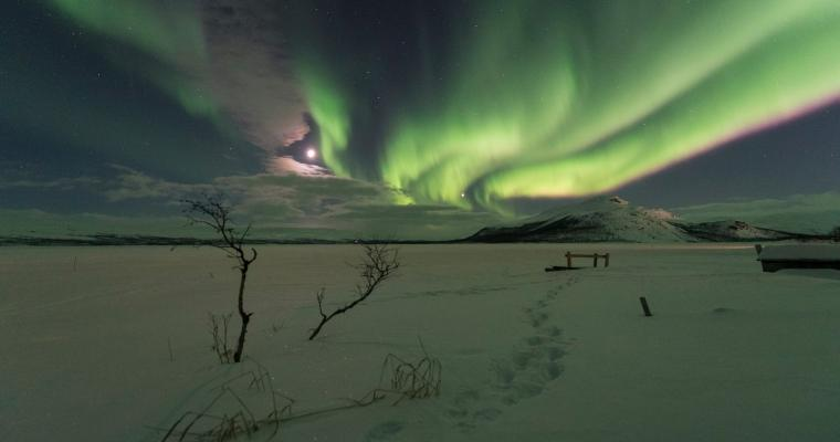 Aurora Borealis dancing with the moon by Lionel Peyraud